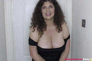 Brunette mature Gilly showing tits and oiling them up prettily